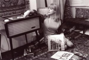 Marianne Faithful listening to records in the sixties